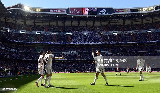 Real Madrid's Welsh forward Gareth Bale celebrates his goal with Real Madrid's Portuguese forward Cristiano Ronaldo and Real Madrid's French forward...