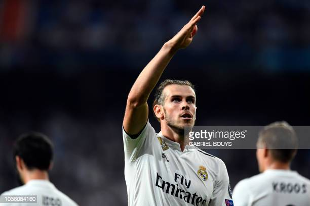 Real Madrid's Welsh forward Gareth Bale celebrates scoring his team's second goal during the UEFA Champions League group G football match between...