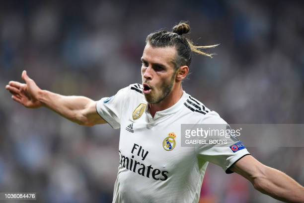 TOPSHOT Real Madrid's Welsh forward Gareth Bale celebrates scoring his team's second goal during the UEFA Champions League group G football match...