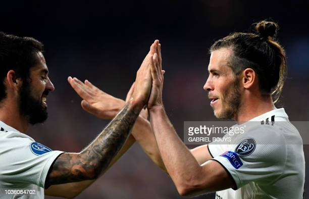 Real Madrid's Welsh forward Gareth Bale celebrates scoring his team's second goal with Real Madrid's Spanish midfielder Isco during the UEFA...