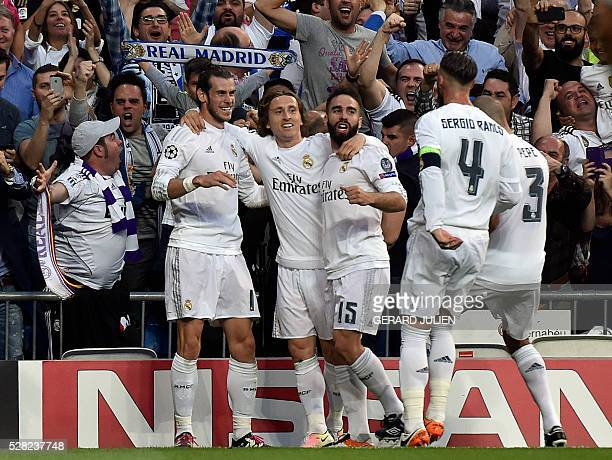 Real Madrid's Welsh forward Gareth Bale celebrates with Real Madrid's Croatian midfielder Luka Modric Real Madrid's defender Dani Carvajaland...