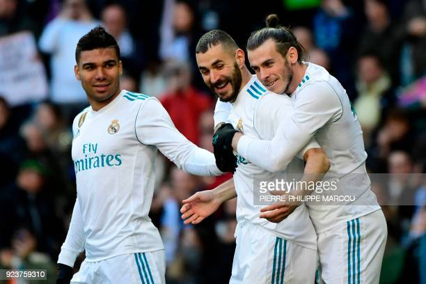 TOPSHOT Real Madrid's Welsh forward Gareth Bale celebrates with Real Madrid's French forward Karim Benzema and Real Madrid's Brazilian midfielder...