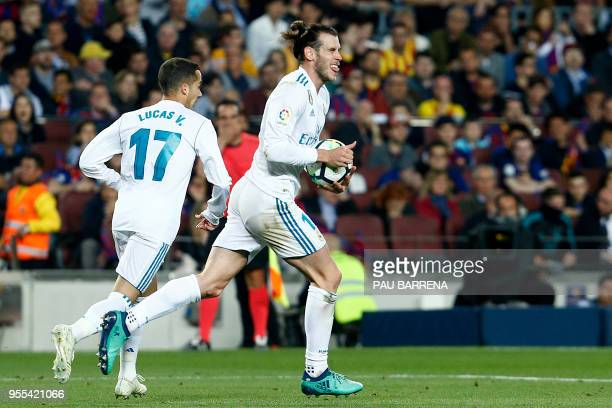 Real Madrid's Welsh forward Gareth Bale celebrates with Real Madrid's Spanish midfielder Lucas Vazquez after scoring a goal during the Spanish league...