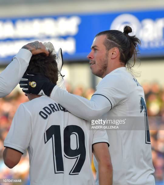 Real Madrid's Welsh forward Gareth Bale celebrates with teammate defender Alvaro Odriozola after scoring his team's first goal during the Spanish...