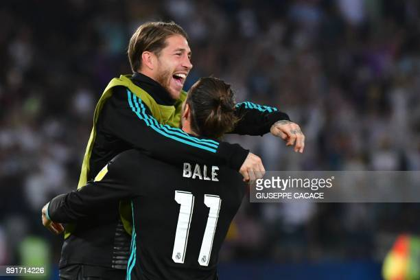 Real Madrid's Welsh forward Gareth Bale celebrates with teammate Sergio Ramos after scoring during the FIFA Club World Cup semifinal match in the...