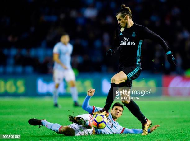 Real Madrid's Welsh forward Gareth Bale challenges Celta Vigo's Argentinian defender Facundo Roncaglia during the Spanish league football match Celta...