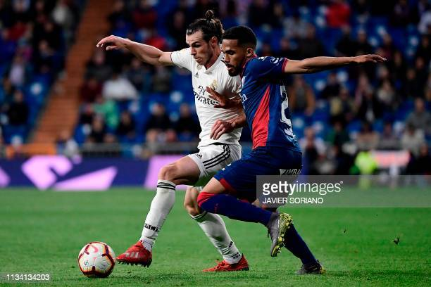 Real Madrid's Welsh forward Gareth Bale challenges SD Huesca's Venezuelan midfielder Yangel Herrera during the Spanish League football match between...