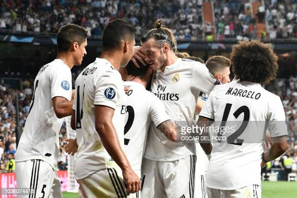 Real Madrid's Welsh forward Gareth Bale congratulates Real Madrid's Spanish midfielder Isco for scoring their team's opening goal during the UEFA...