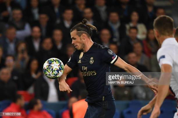 Real Madrid's Welsh forward Gareth Bale controls the ball before shooting and scoring during the UEFA Champions league Group A football match between...