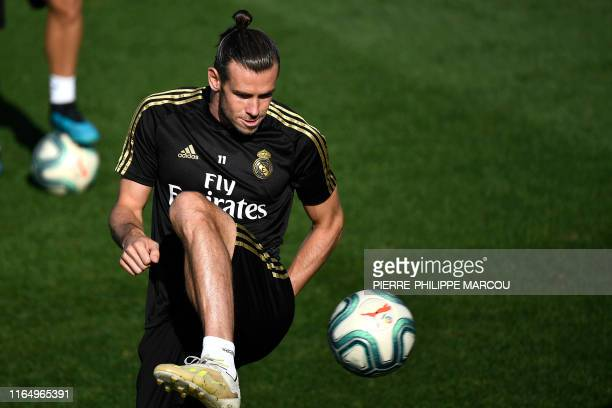 Real Madrid's Welsh forward Gareth Bale controls the ball during a training session at the Ciudad Real Madrid training ground in Valdebebas, near...