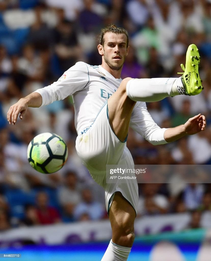 Real Madrid's Welsh forward Gareth Bale controls the ball during the Spanish Liga football match Real Madrid vs Levante at the Santiago Bernabeu stadium in Madrid on September 9, 2017. /