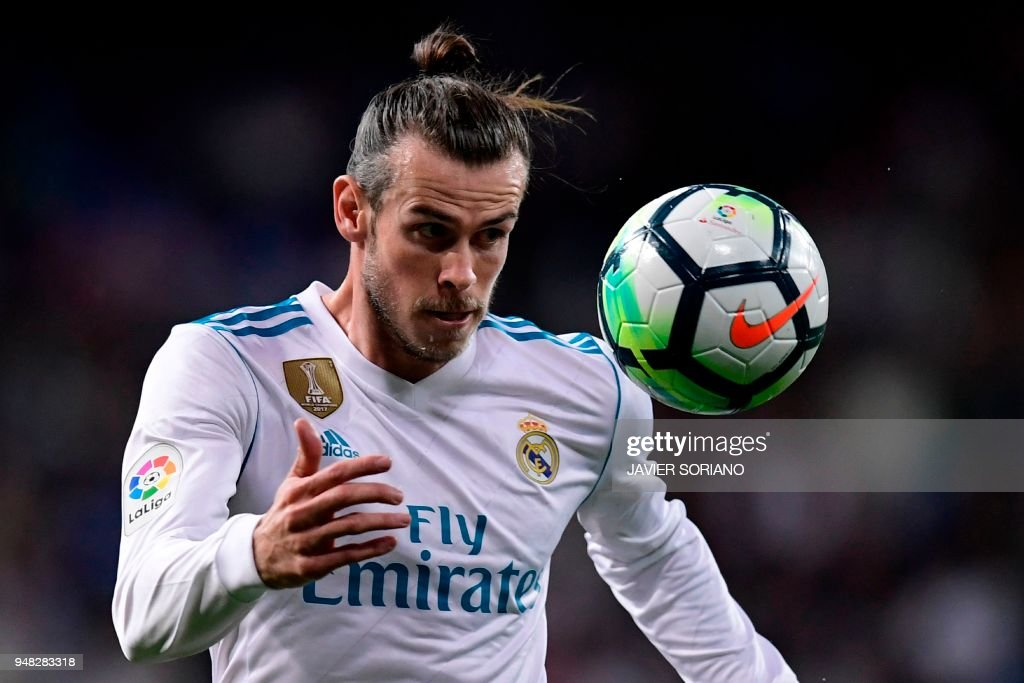 Real Madrid's Welsh forward Gareth Bale eyes the ball during the Spanish league football match Real Madrid CF against Athletic Club Bilbao at the Santiago Bernabeu stadium in adrid on April 18, 2018. /