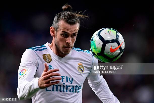 Real Madrid's Welsh forward Gareth Bale eyes the ball during the Spanish league football match Real Madrid CF against Athletic Club Bilbao at the...