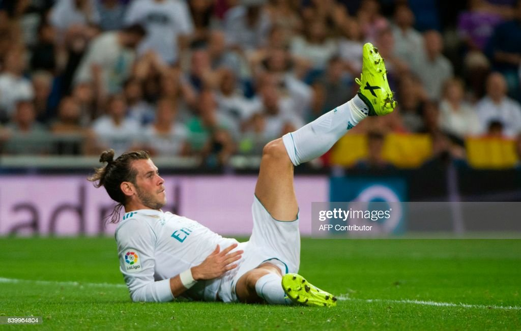 Real Madrid's Welsh forward Gareth Bale gestures after a fall during the Spanish league football match Real Madrid CF vs Valencia CF at the Santiago Bernabeu stadium in Madrid on August 27, 2017. The game ended with a draw 2-2. /