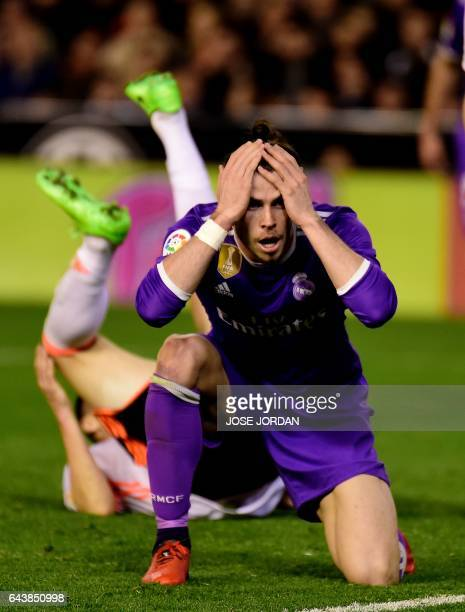 Real Madrid's Welsh forward Gareth Bale gestures after missing an attempt on goal during the Spanish league football match Valencia CF vs Real Madrid...