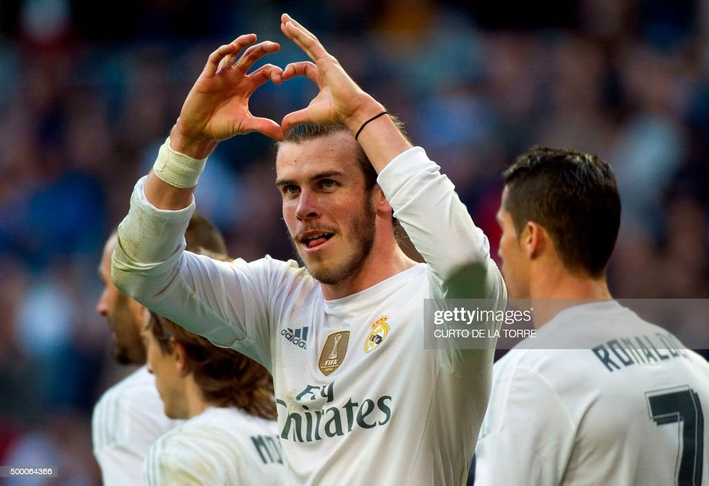Real Madrid's Welsh forward Gareth Bale gestures as he celebrates a goal during the Spanish league football match Real Madrid CF vs Getafe CF at the Santiago Bernabeu stadium in Madrid on December 5, 2015. /