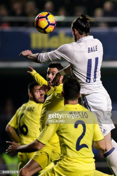 Real Madrid's Welsh forward Gareth Bale heads the ball to score a goal during the Spanish League football match Villarreal CF vs Real Madrid at El...