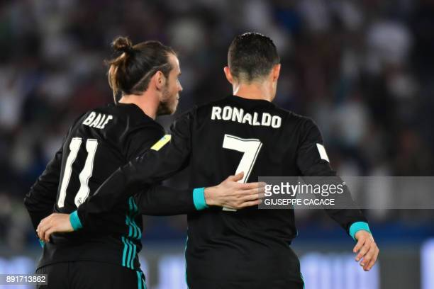 Real Madrid's Welsh forward Gareth Bale is congratulated after scoring by teammate Portuguese forward Cristiano Ronaldo during the FIFA Club World...