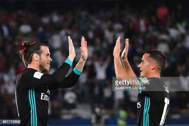 Real Madrid's Welsh forward Gareth Bale is congratulated after scoring by teammate Spanish forward Lucas Vázquez during the FIFA Club World Cup...