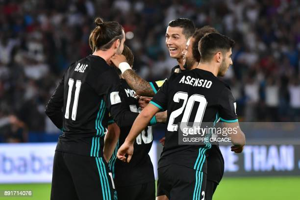 Real Madrid's Welsh forward Gareth Bale is congratulated after scoring by teammates Luka Modric Cristiano Ronaldo Marcelo and Sergio Asensio during...
