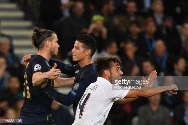 Real Madrid's Welsh forward Gareth Bale is congratulated by Real Madrid's Colombian midfielder James Rodriguez after scoring a goal while Paris...