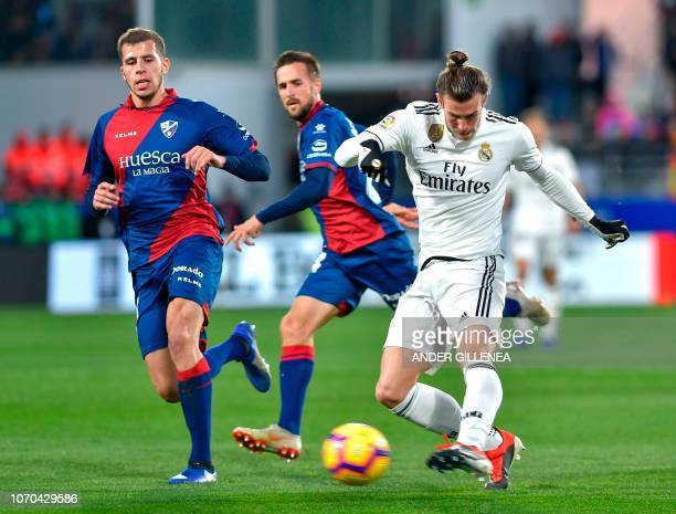 Real Madrid's Welsh forward Gareth Bale kicks the ball during the Spanish league football match between SD Huesca and Real Madrid CF at the El...