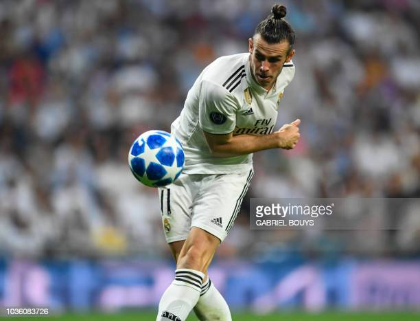 Real Madrid's Welsh forward Gareth Bale misses a goal opportunity during the UEFA Champions League group G football match between Real Madrid CF and...