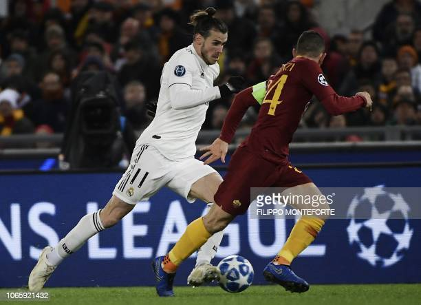 Real Madrid's Welsh forward Gareth Bale outruns AS Roma Greek defender Konstantinos Manolas during the UEFA Champions League group G football match...