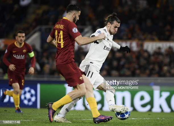 Real Madrid's Welsh forward Gareth Bale prepares to shoot on goal and open the scoring despite AS Roma Greek defender Konstantinos Manolas during the...