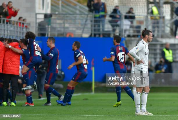 Real Madrid's Welsh forward Gareth Bale reacts after Eibar's Argentinian midfielder Gonzalo Escalante scored a goal during the Spanish league...