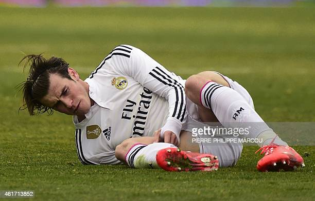 Real Madrid's Welsh forward Gareth Bale reacts after hurting his leg during the Spanish league football match Getafe CF vs Real Madrid CF at the...