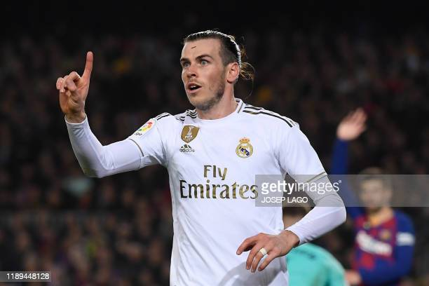 "Real Madrid's Welsh forward Gareth Bale reacts during the ""El Clasico"" Spanish League football match between Barcelona FC and Real Madrid CF at the..."