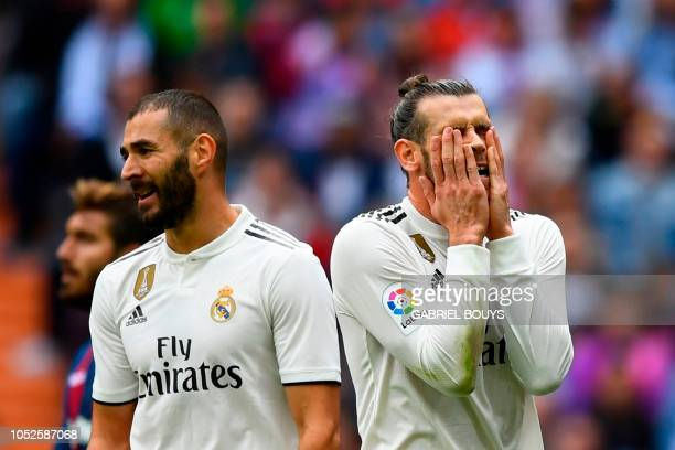 TOPSHOT Real Madrid's Welsh forward Gareth Bale reacts next to Real Madrid's French forward Karim Benzema during the Spanish league football match...