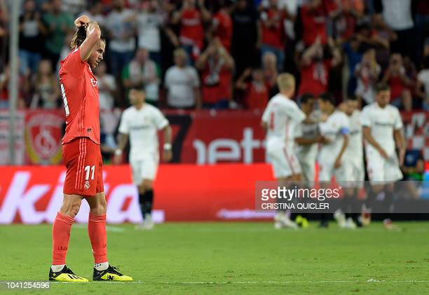 Real Madrid's Welsh forward Gareth Bale reacts Sevilla's Portuguese forward Andre Silva's goal during the Spanish league football match Sevilla FC...