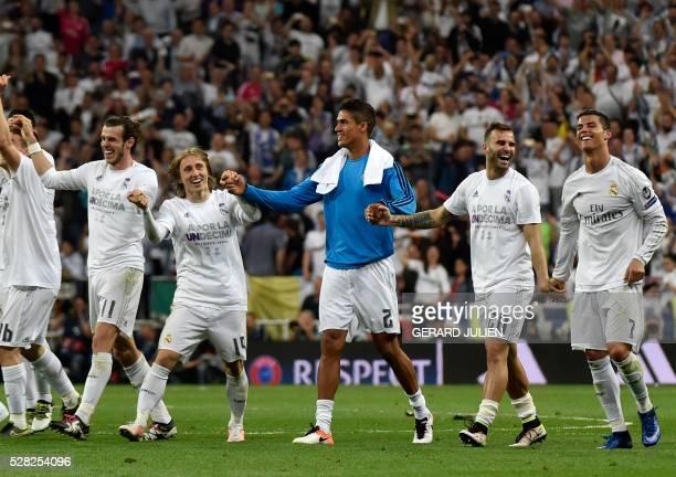 Real Madrid's Welsh forward Gareth Bale Real Madrid's Croatian midfielder Luka Modric Real Madrid's French defender Raphael Varane Real Madrid's...