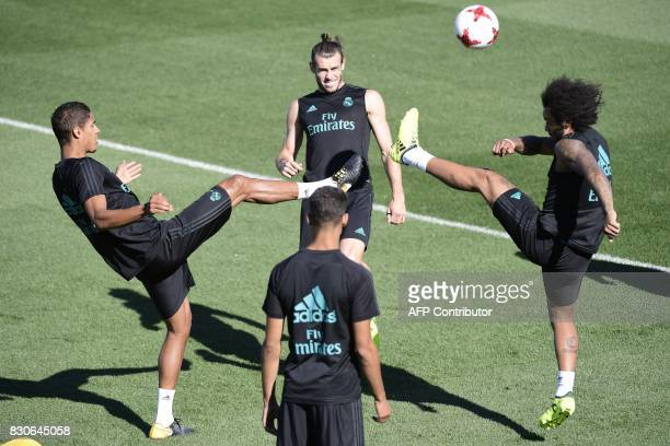 Real Madrid's Welsh forward Gareth Bale Real Madrid's French defender Raphael Varane and Real Madrid's Brazilian defender Marcelo take part in a...