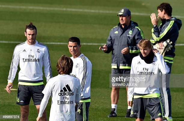 Real Madrid's Welsh forward Gareth Bale Real Madrid's Portuguese forward Cristiano Ronaldo Real Madrid's coach Rafael Benitez and Real Madrid's...