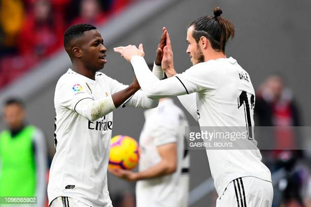 Real Madrid's Welsh forward Gareth Bale replaces Real Madrid's Brazilian forward Vinicius Junior during the Spanish league football match between...