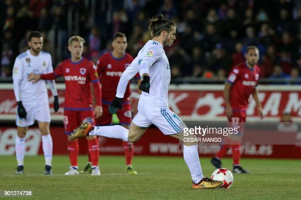 Real Madrid's Welsh forward Gareth Bale shoots a penalty kick to score a goal during the Spanish Copa del Rey round of 16 first leg football match CD...