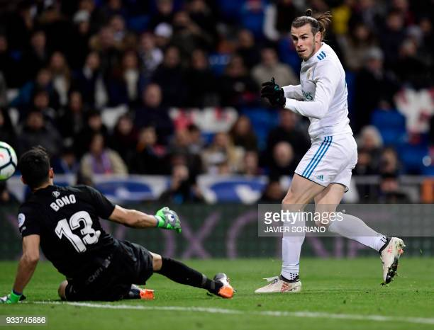 Real Madrid's Welsh forward Gareth Bale shoots to score a goal during the Spanish League football match between Real Madrid CF and Girona FC at the...
