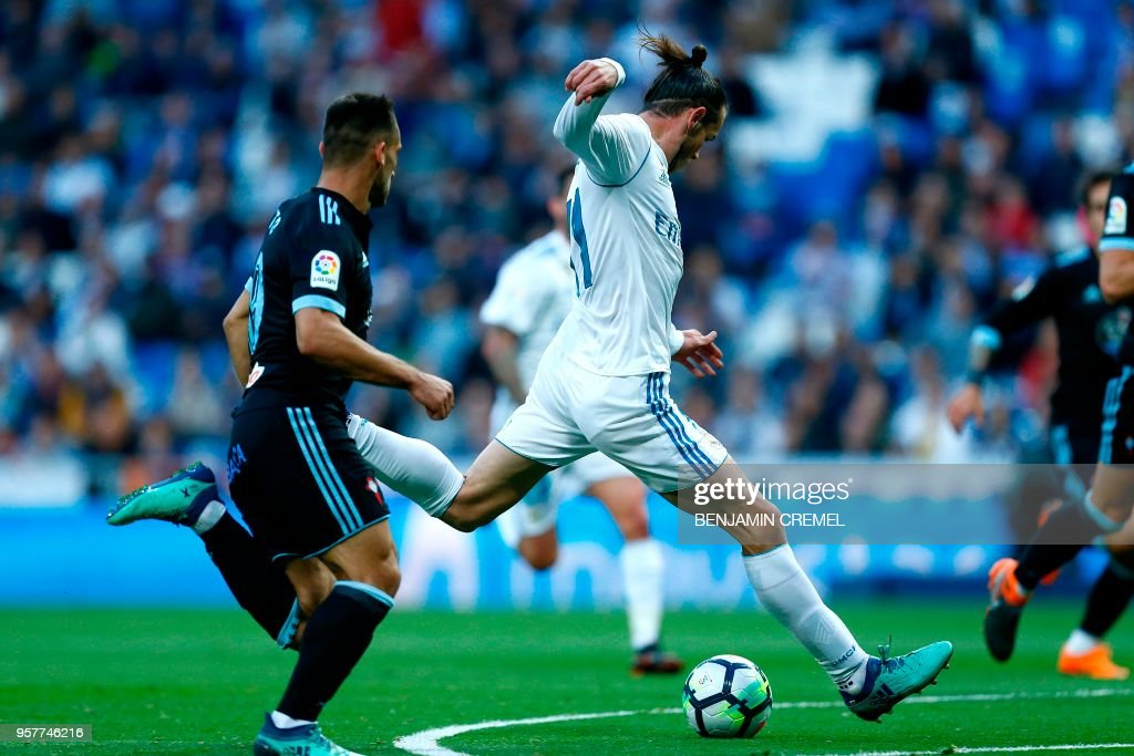 TOPSHOT - Real Madrid's Welsh forward Gareth Bale shoots to score a goal during the Spanish league football match between Real Madrid and Celta Vigo at the Santiago Bernabeu stadium in Madrid on May 12, 2018.