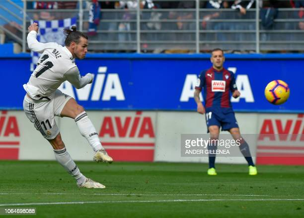 Real Madrid's Welsh forward Gareth Bale shots the ball during the Spanish league football match between SD Eibar and Real Madrid CF at the Ipurua...
