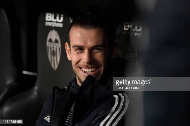 Real Madrid's Welsh forward Gareth Bale smiles before the Spanish league football match between Valencia CF and Real Madrid CF at the Mestalla...