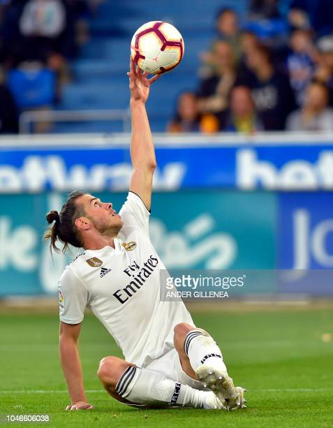 Real Madrid's Welsh forward Gareth Bale touches the ball during the Spanish league football match between Deportivo Alaves and Real Madrid CF at the...