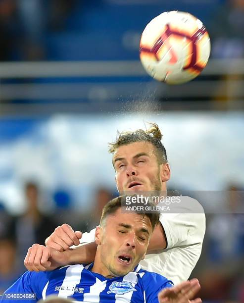 Real Madrid's Welsh forward Gareth Bale vies with Alaves' Spanish defender Ximo Navarro during the Spanish league football match between Deportivo...