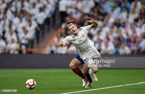 Real Madrid's Welsh forward Gareth Bale vies with Atletico Madrid's Spanish midfielder Saul Niguez during the Spanish league football match between...