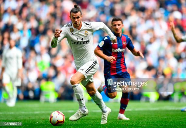 Real Madrid's Welsh forward Gareth Bale vies with Levante's Macedonian midfielder Enis Bardhiduring the Spanish league football match Real Madrid CF...