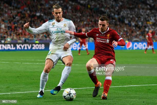 Real Madrid's Welsh forward Gareth Bale vies with Liverpool's Scottish defender Andrew Robertson during the UEFA Champions League final football...