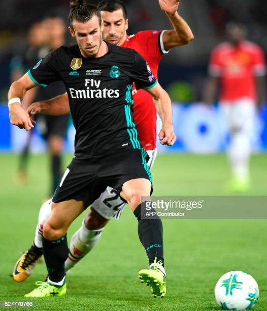 Real Madrid's Welsh forward Gareth Bale vies with Manchester United's Armenian midfielder Henrikh Mkhitaryan during the UEFA Super Cup football match...