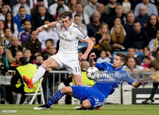 Real Madrid's Welsh forward Gareth Bale vies with Schalke's Serbian defender Matija Nastasic during the round of 16 second leg UEFA Champions League...